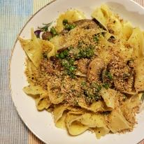Pappardelle with mushrooms, peas, garlic, and walnut parm
