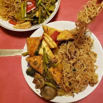 Tofu and veggie stir fry with crispy fried noodles