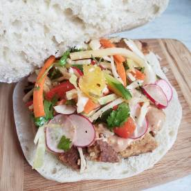 Homemade pita with marinated tempeh, asian slaw, and peanut butter sauce