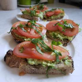 Homemade sourdough with avocado, tomato, and basil