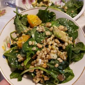 Spinach salad with barley, avocado, orange, and cashews