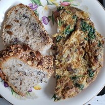 Mushroom spinach omlette with homemade seeded sourdough