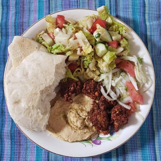 Homemade pita, hummus, falafel, and salad