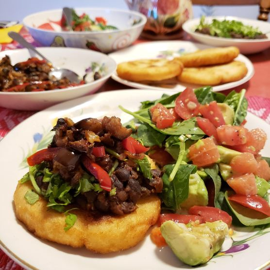 Arepas with black beans and salad